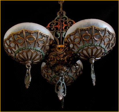 Title: Gill Glass Company Light Fixture - Description: 1930s Art Deco three light ceiling fixture by the Gill Glass Co. Original polychrome finish in antique gold, red and green on elaborate cast frame plus three bowl style glass shades with finials.