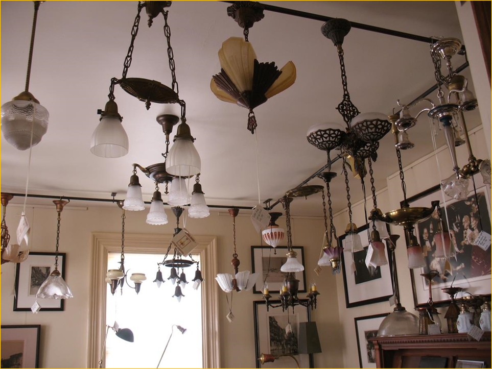 Title: Antique Lighting - Description: Interior photo of Harris House Antique Lighting near Halifax, Nova Scotia showing a selection of restored and rewired vintage ceiling fixtures.